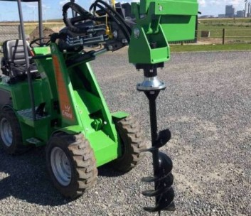 Auger attached to mini loader