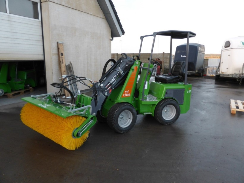 Broom attached to mini loader