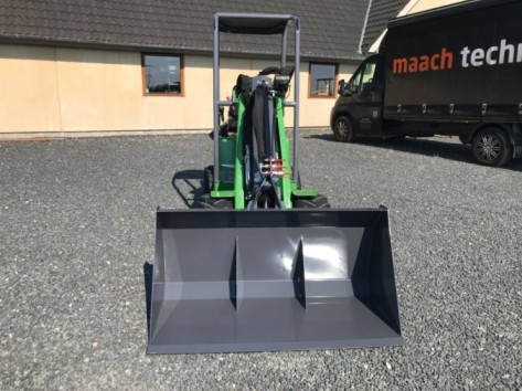 Light material bucket in front of mini loader