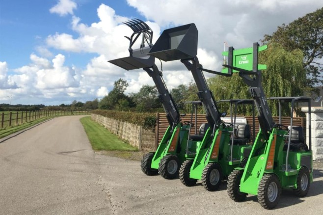 Mini loader with extended attachments