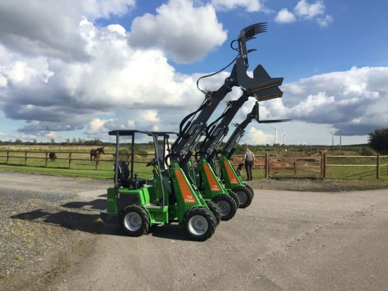 Three mini loaders with different attachments